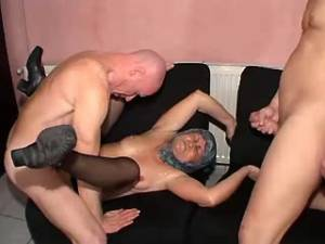 Guys with hard cocks share granny in wild orgy