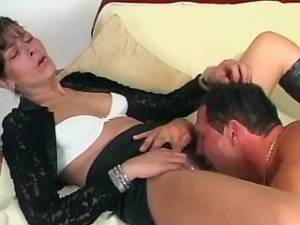 Aged lady in high boots sucking appetizing cock