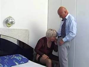 Lewd granny in stockings sucks cock of older man