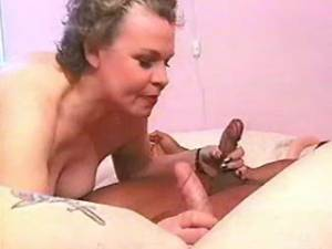 Lewd granny sucks hard interracial cocks by turns