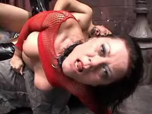 Grandma in latex boots gets big mouthful in group