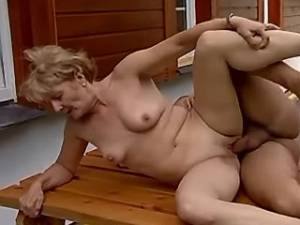 Blonde old lady gets fuck on table