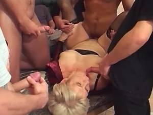 Blonde milf gets facial in gangbang