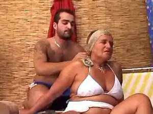 Granny in bikini relaxes with guy and sucks cock