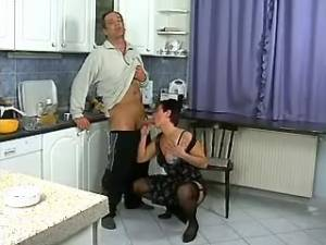 Depraved granny deep sucks strong cock on kitchen