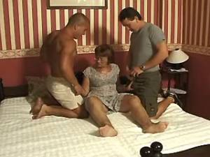 Old lady greedily sucks two strong cocks by turns