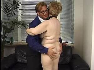 Depraved granny jumps on strong dick in office
