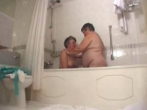 Lewd old lesbians caress each other in bathroom