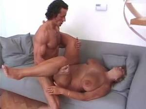 Stud drills plump granny with huge tits on sofa
