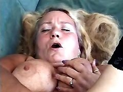 Lewd granny fucks herself on couch