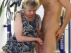 Horny granny blows hot coach in gym