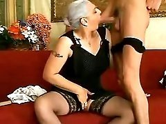 Old dama sucking cock of young guy