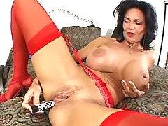 Mature in red stockings sucks cock