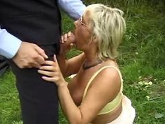 Old lady sucks hard cock in nature