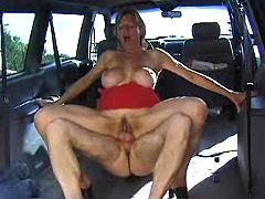 Mature blonde fucking hard in a car