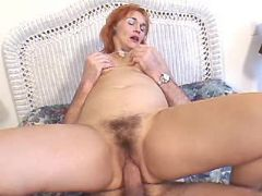 Redhead mature rides strong cock