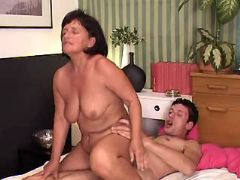 Lusty granny jumps on dick of guy