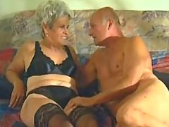 Grey haired granny gets fuck on bed