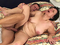 The old babe gets fucked and takes his cum right as her daughter walks in on it