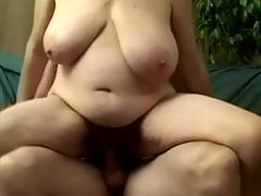 Chubby granny rides and catches cum
