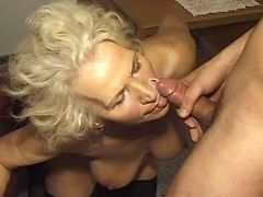 Plump granny gets cumload on face