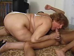Fat grandma sucks hard cock of guy