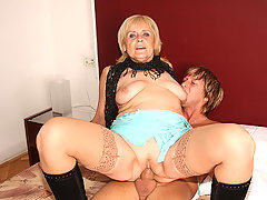 The mature has a nice ass and is wearing boots as she gets fucked like the hooker she is