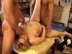 Two guys share chubby granny in group