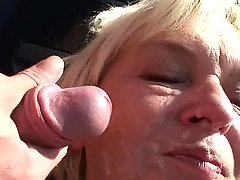 Pretty granny taking a load of his cum on her face after a torrid outdoor fuck scene