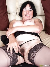 Mature brunette in sexy black lingerie is here for you