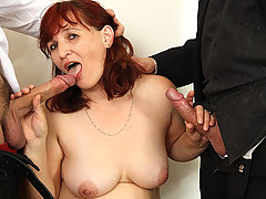 The awesomely hot mature redhead loses at strip poker and has to get fucked by the guys