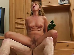Lustful mature gives head and rides cock