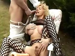 Naughty grandma sucks cock outdoor